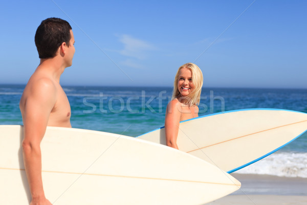 Couple with their surfboards Stock photo © wavebreak_media