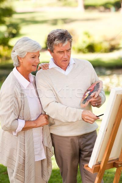 Retired couple painting in the park Stock photo © wavebreak_media