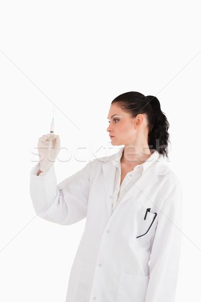 Doktor bakıyor şırınga beyaz kadın el Stok fotoğraf © wavebreak_media