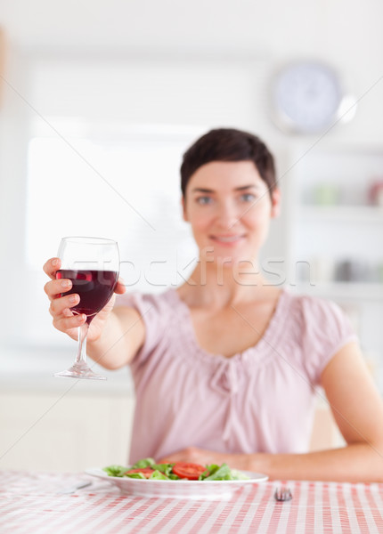 Cute brunette Woman toasting with wine in a kitchen Stock photo © wavebreak_media