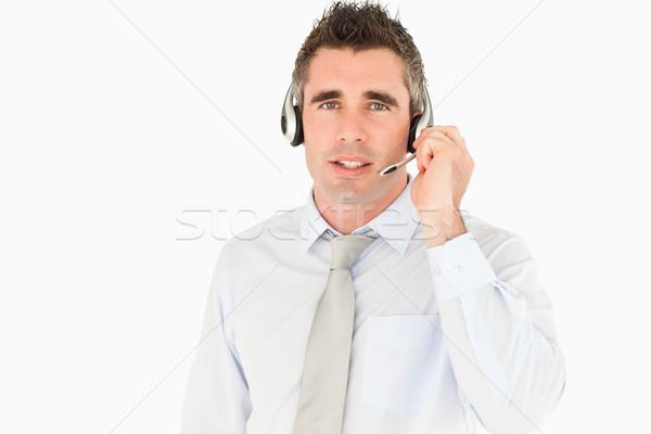 Male secretary speaking through a headset against a white background Stock photo © wavebreak_media