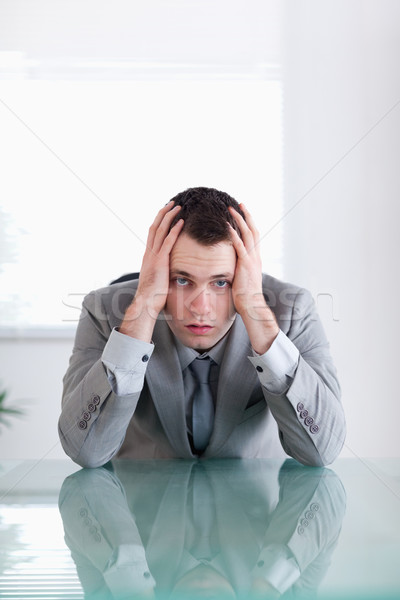 Close up of businessman after failure sitting behind a table Stock photo © wavebreak_media
