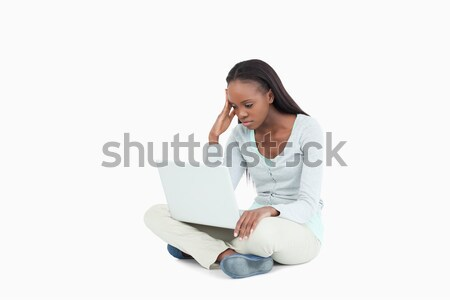Woman sitting on the floor experiencing laptop problems against a white background Stock photo © wavebreak_media