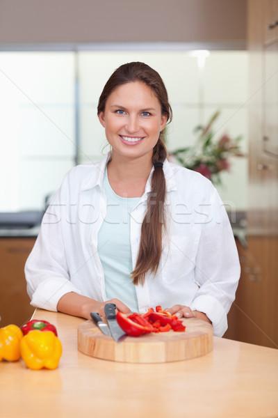 Portrait of a woman slicing a pepper in her kitchen Stock photo © wavebreak_media