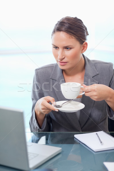 Portrait of a businesswoman drinking coffee in her office Stock photo © wavebreak_media