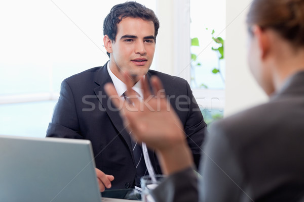 Handsome manager interviewing a female applicant in his office Stock photo © wavebreak_media