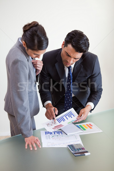 Portrait of focused sales persons studying statistics in an office Stock photo © wavebreak_media