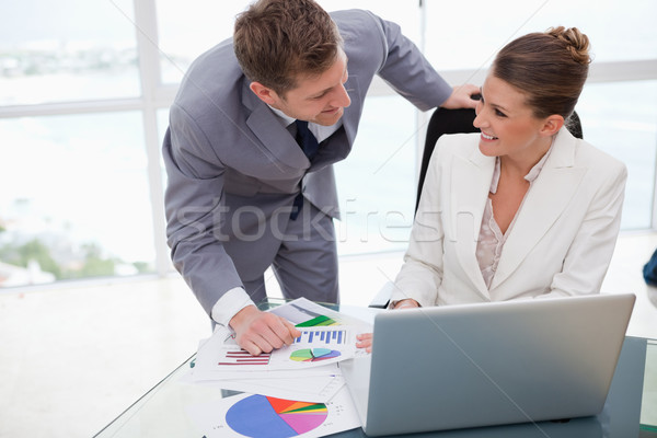 Business team analyzing poll results together Stock photo © wavebreak_media