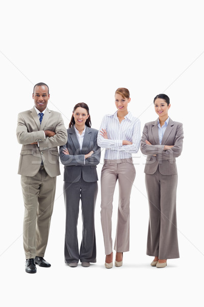 Business team smiling side by side and crossing their arms against white background Stock photo © wavebreak_media
