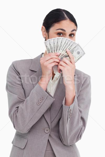 Fiatal elarusítónő rejtőzködik arc mögött bank Stock fotó © wavebreak_media