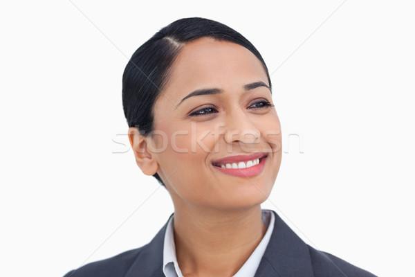 Közelkép mosolyog elarusítónő néz oldal fehér Stock fotó © wavebreak_media
