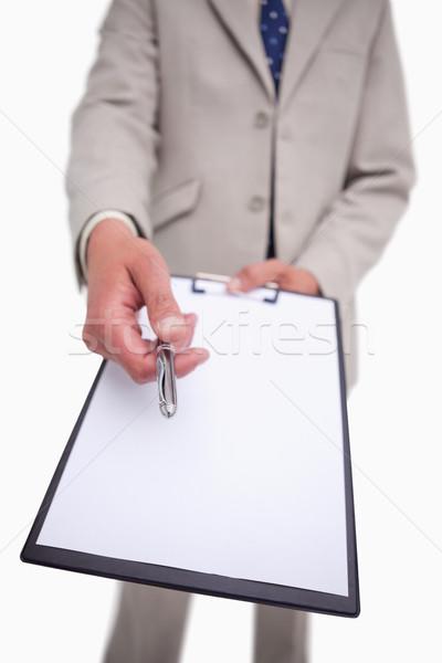 Businessman asking for signature against a white background Stock photo © wavebreak_media