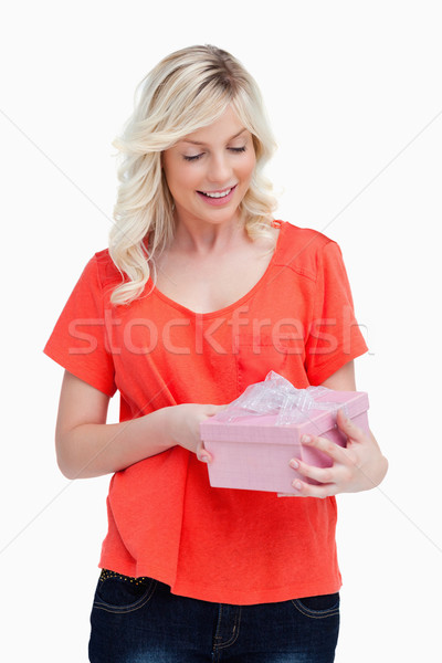 Surprised fair-haired teenager receiving a gift against a white background Stock photo © wavebreak_media