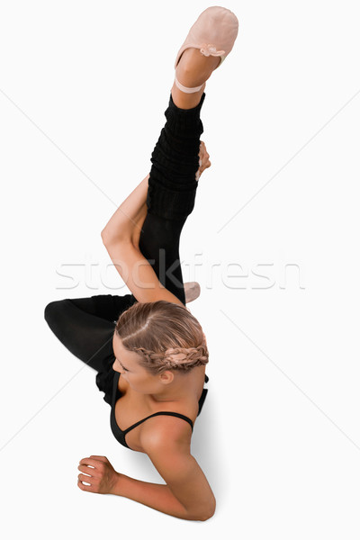 Overhead view of stretching dancer against a white background Stock photo © wavebreak_media
