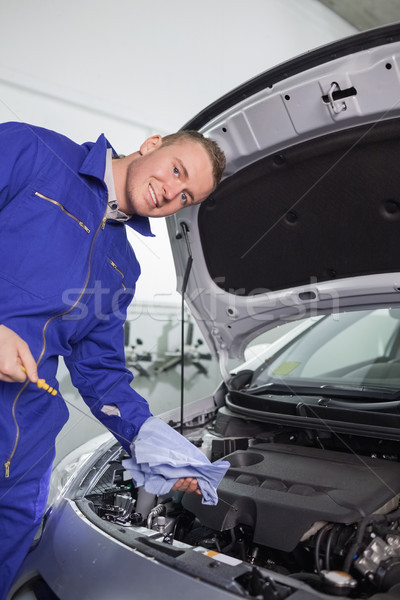 Mechanic holding a dipstick in a garage Stock photo © wavebreak_media