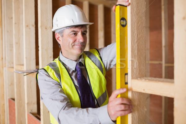 Architect measuring the wood frame with a spirit level Stock photo © wavebreak_media