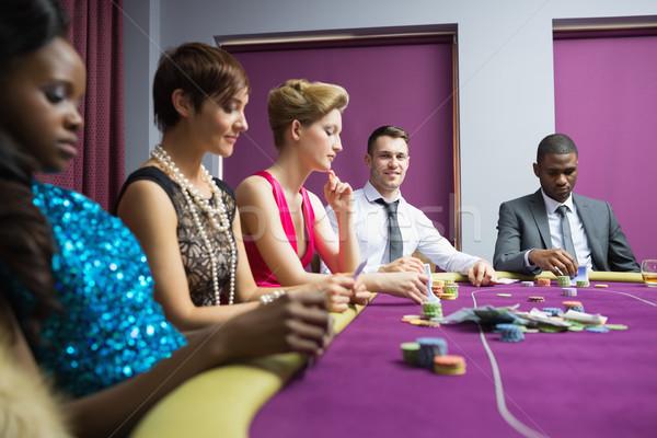 Emberek ül póker asztal kaszinó nő Stock fotó © wavebreak_media
