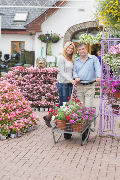 Couple pushing a trolley full of flowers outside in garden center Stock photo © wavebreak_media