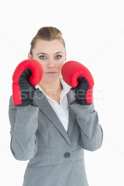 Businesswoman with boxing gloves looking serious Stock photo © wavebreak_media