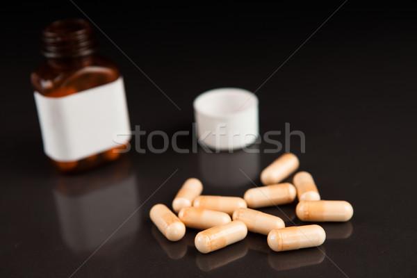 Cápsulas fuera jar negro Foto stock © wavebreak_media