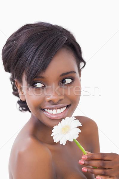 Nő másfelé néz mosolyog tart százszorszép virág Stock fotó © wavebreak_media
