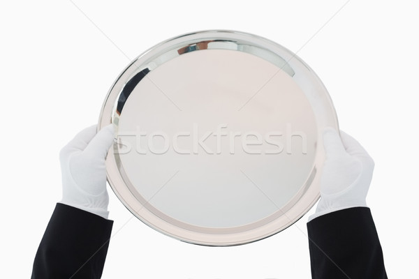 Silver tray being held out by man in suit and gloves Stock photo © wavebreak_media