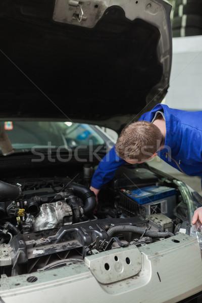 Mechanic working under bonnet of car Stock photo © wavebreak_media