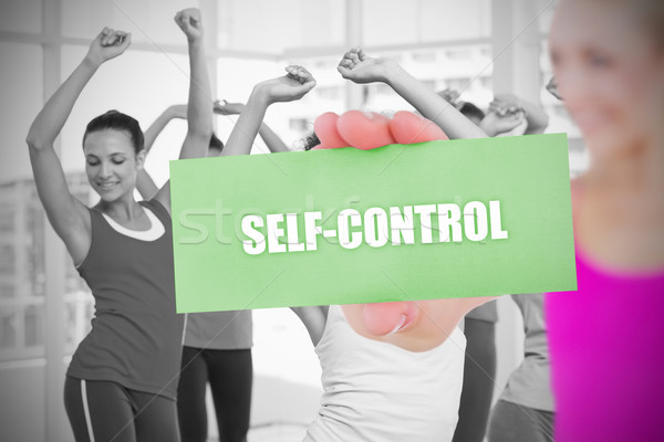 Fit blonde holding card saying self control Stock photo © wavebreak_media