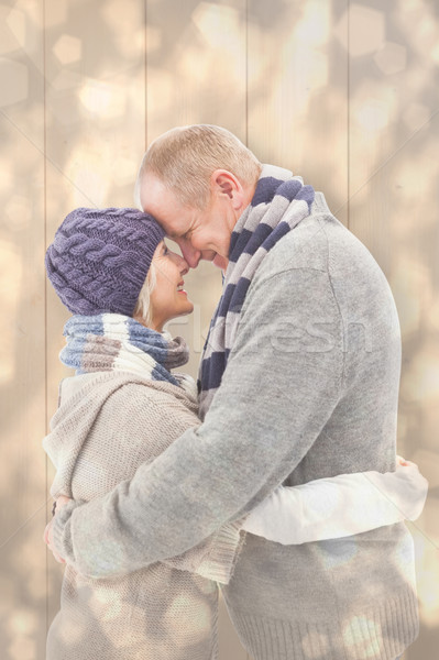 Composite image of happy mature couple in winter clothes hugging Stock photo © wavebreak_media