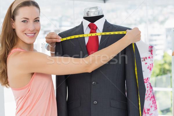 Female fashion designer measuring suit on dummy Stock photo © wavebreak_media