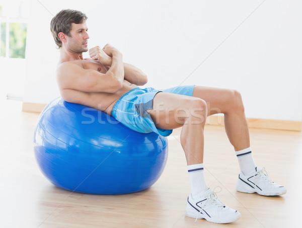 Gömleksiz adam egzersiz uygunluk top spor salonu Stok fotoğraf © wavebreak_media