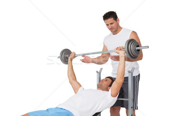 Edző segít fitt férfi lift súlyzó Stock fotó © wavebreak_media