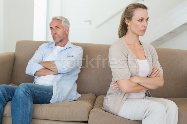 Angry couple sitting on couch not talking to each other Stock photo © wavebreak_media