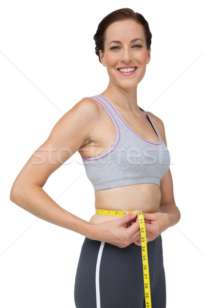 Portrait of a fit woman measuring waist Stock photo © wavebreak_media