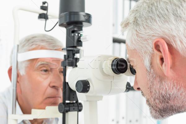 Optometrist doing sight testing for senior patient Stock photo © wavebreak_media