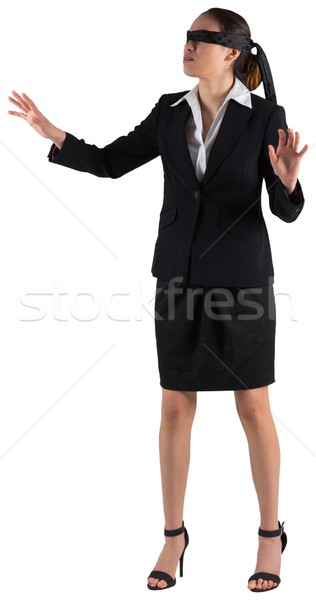 Blindfolded businesswoman with hands out Stock photo © wavebreak_media