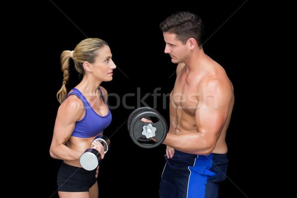 Crossfit pár pózol súlyzók fekete nő Stock fotó © wavebreak_media