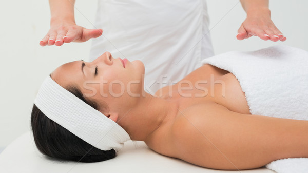 Peaceful brunette getting reiki therapy Stock photo © wavebreak_media