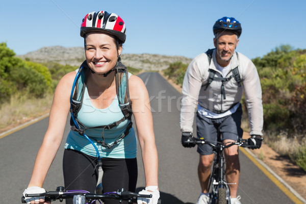 Active couple going for a bike ride in the countryside Stock photo © wavebreak_media