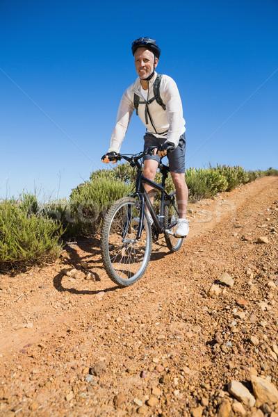 Fitt kerékpáros biciklizik vidék terep napos idő Stock fotó © wavebreak_media