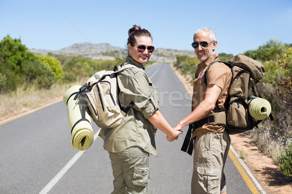 Hitch hiking couple standing holding hands on the road Stock photo © wavebreak_media