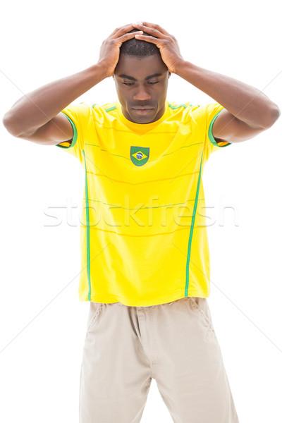 Csalódott futball ventillátor lefelé néz fehér sport Stock fotó © wavebreak_media