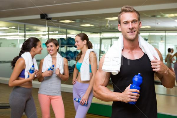 Montare uomo sorridere fotocamera occupato fitness Foto d'archivio © wavebreak_media