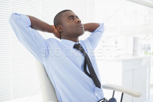 Nyugodt üzletember ül szék iroda gondolkodik Stock fotó © wavebreak_media