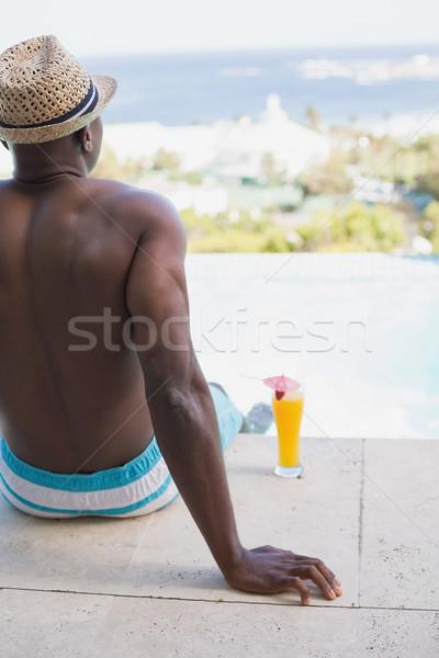 Man in swimming trunks relaxing poolside Stock photo © wavebreak_media