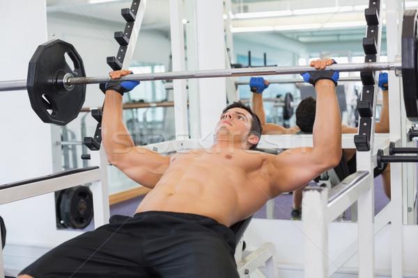 Gespierd man barbell gymnasium shirtless Stockfoto © wavebreak_media