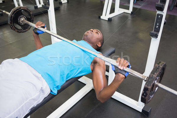 Determinado moço barbell ginásio Foto stock © wavebreak_media