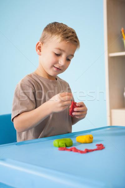 Cute peu garçon jouer argile classe Photo stock © wavebreak_media