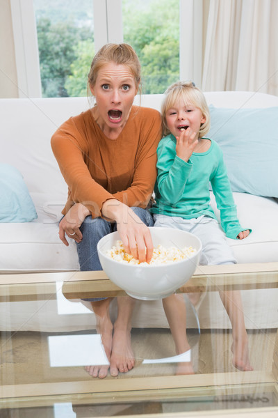 Happy mother and daughter watching tv Stock photo © wavebreak_media