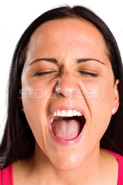 Angry young brunette shouting in close up Stock photo © wavebreak_media